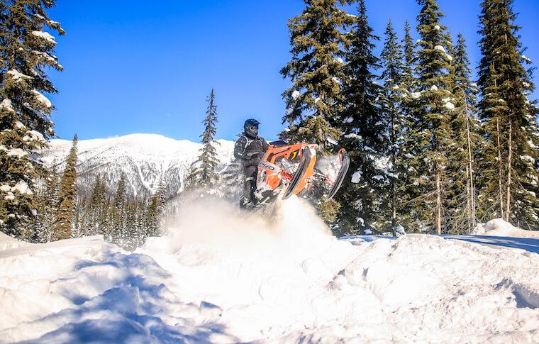 Snowmobiler Taking Air
