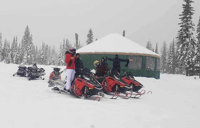Stop at a Yurt Hut on a Guided Snowmobile Tour