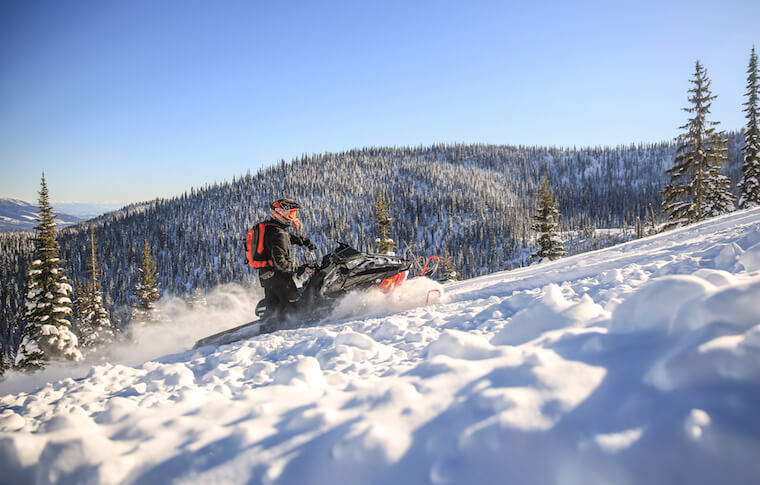 Snowmobiling Up a Mountain in MT